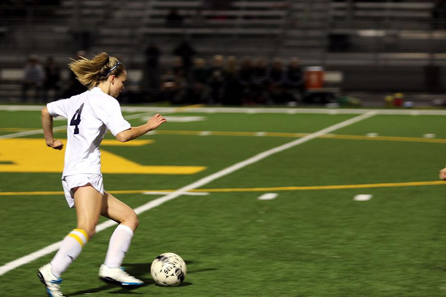 Senior Bre Morren receives the ball and pushes towards the MG goal to finish her hat trick.