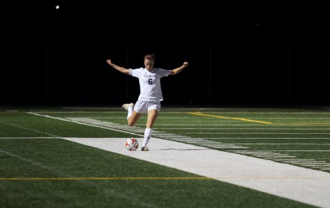 Arlington's Channing Hudson ('16) in mid-kick during a home game versus Bothell on September 15th.