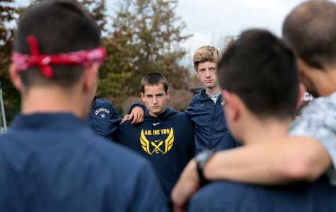 Zane Blanken ('16) listens intently to Coach Murray while he prepares for the race at McCollum Park.