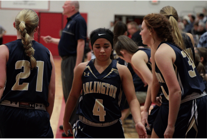 Senior Serafina Balderas high-fives teammates as she comes off the court during Arlington's victory over Stanwood on February 3rd.