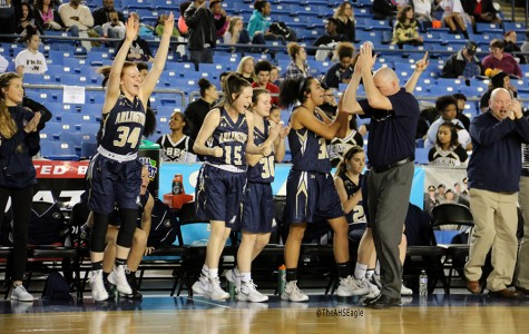 The Arlington girls' basketball team cheers as they defeat Lincoln on March 3rd at the Tacoma Dome.