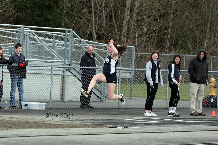 Mary Catherine Meno (17) completes the long jump during a meet on March 24th.