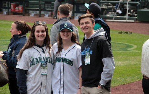Rachel Hunter ('17), Megan Chapman ('16), and Edward Radion ('17) celebrate on the field after Chapman's first pitch.