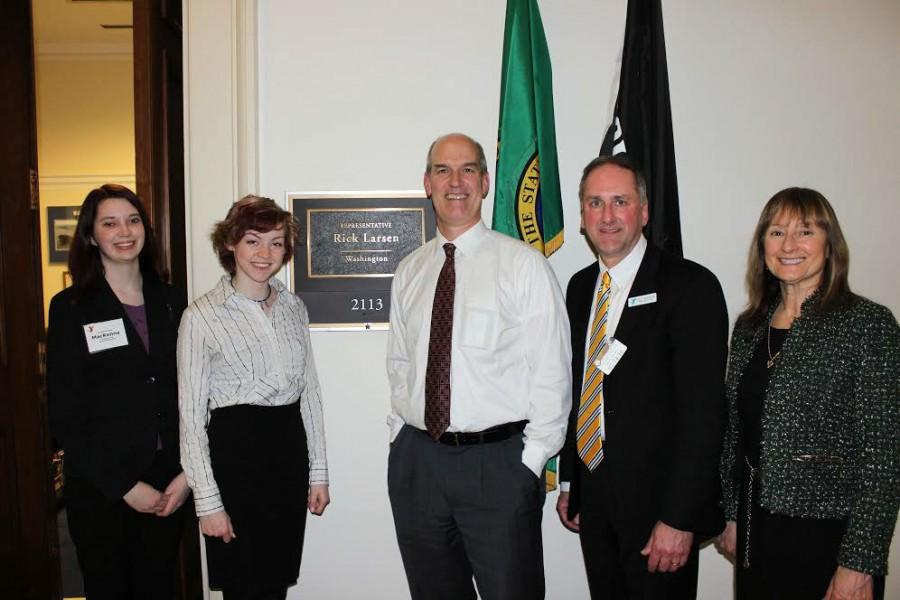 Makenna Kelly stands with fellow YMCA Youth Advocate Molly Randall, as well as Congressman Rick Larsen and YMCA Directors Scott Washburn and Sue Anderson.