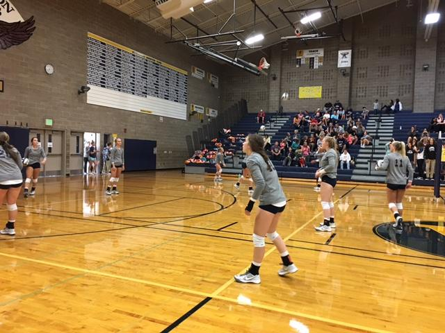Varsity Volleyball warming up before their game against the Newport Knights.