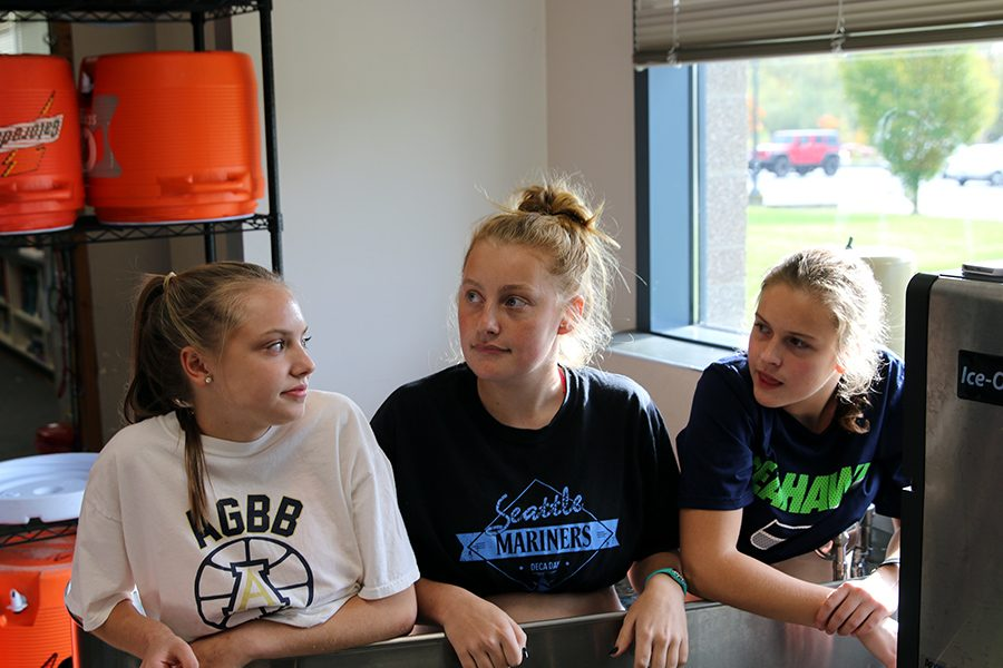 Kate Morris ('19), Charlize Beamer ('19), and Brittany Anderson ('19) prepare for their race at Cedarcrest Golf Course in Marysville on Friday, September 30th.