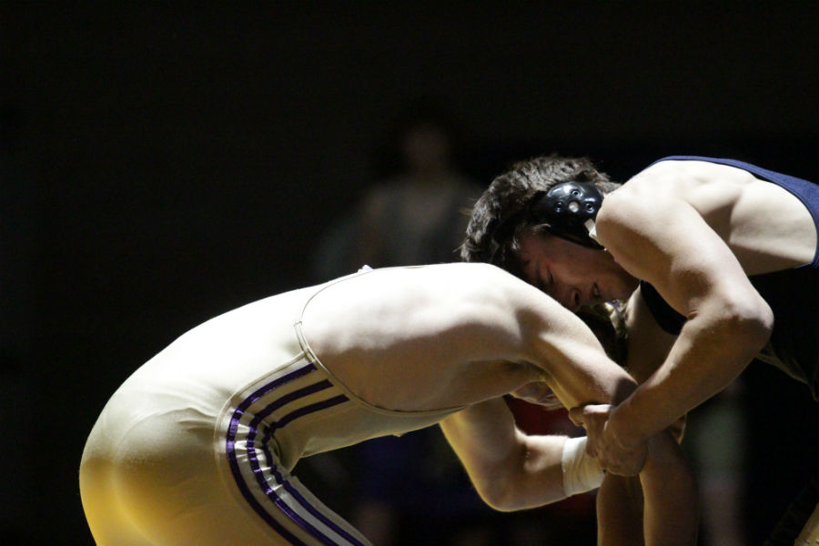 Sophomore wrestler Cole Hahn battles against Oak Harbor at weight class 160 on January 12.