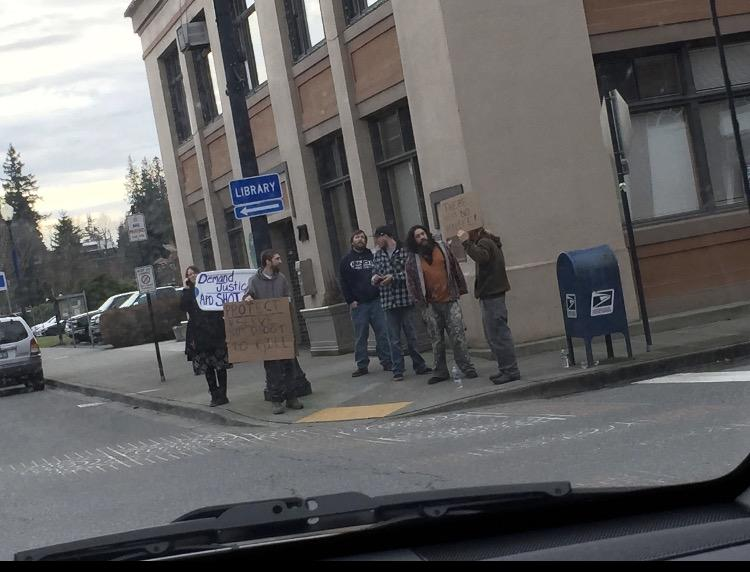 Protestors are seen next to City Hall in response to Tuesdays Shooting. The motive of the protestors is unknown at this time.