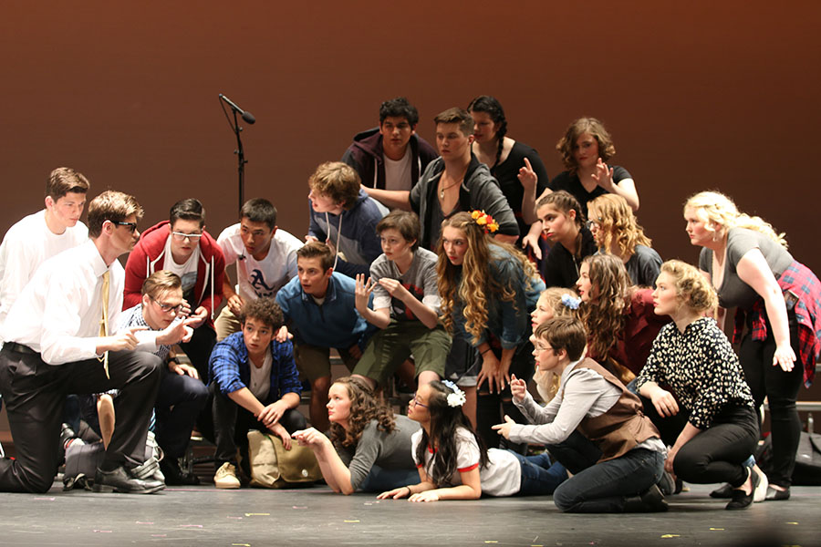 Steven performers gather around their teacher, listening for their new project. During the first first performance Friday night, 9.20