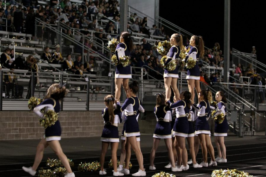 The Arlington Eagle cheerleaders preforming at the Sept. 8 game hypng up the game while we fought a difficult game against the Lake Stevens Vikings.