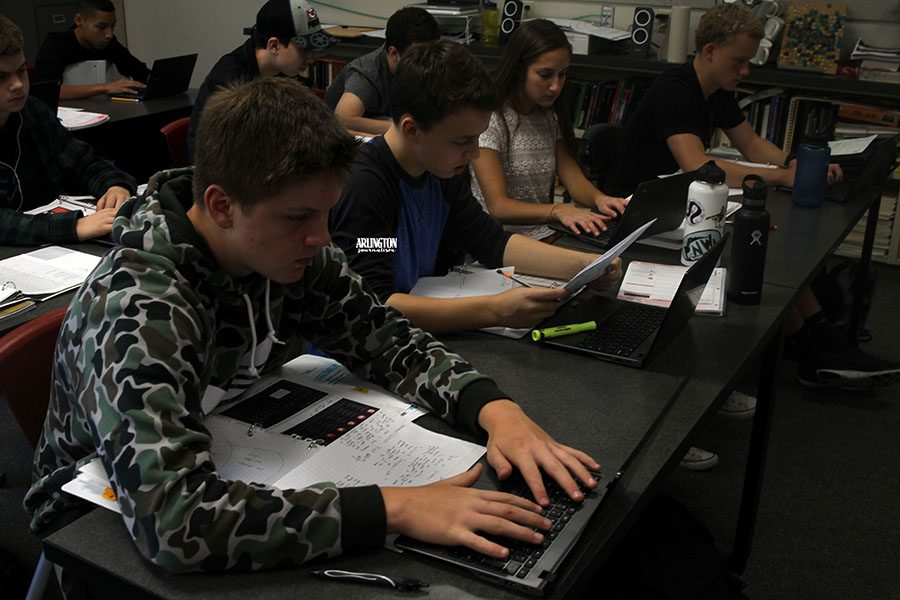 An English 10 class works on their assignments on the classroom chromebooks.