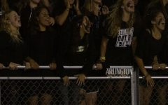 The senior section cheers on the varsity football team at the first home game of the year