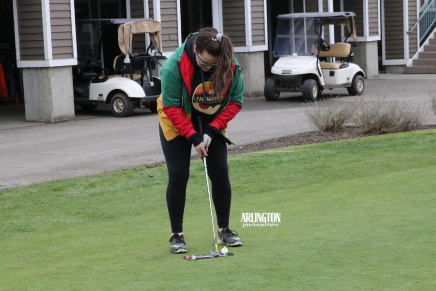 Cristina Hutchens ('19) practices on her putting skills at a practice leading up to the golf teams first match.