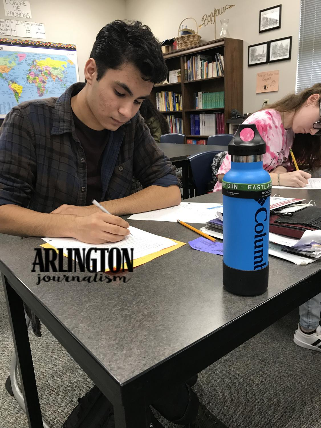 Naveed Arang (11) practices his irregular verbs in French 3. Studying for french class has been apart of Arang's school routine since freshman year.