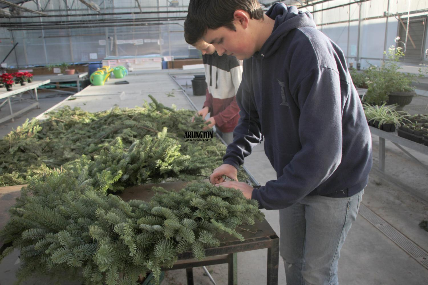 Simon Fuentes (10) makes a wreath for the FFA's fundraiser.