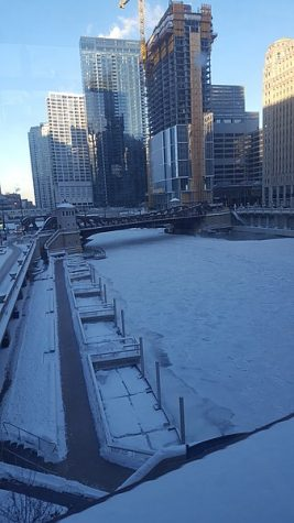 Chicago River, Illinois frozen over from the Polar Vortex.   Photo from Wikimedia Commons Taken by David Pyle