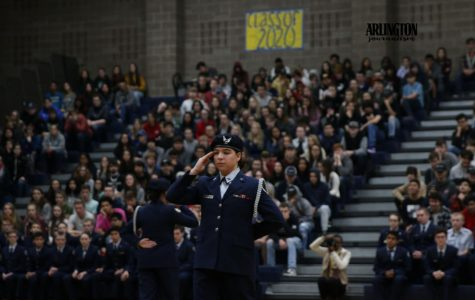 Samrie Feria(11) and partner Areanna Schuerman(11) show off there duel routine at the Veterans Day Assembly.