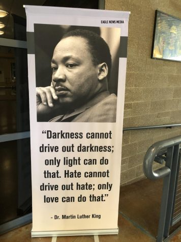 "A poster of MLK with his quote, ""Darkness cannot drive out darkenss; only light can do that. Hate cannot drive out hate; only love can do that"" is displayed in the commons."