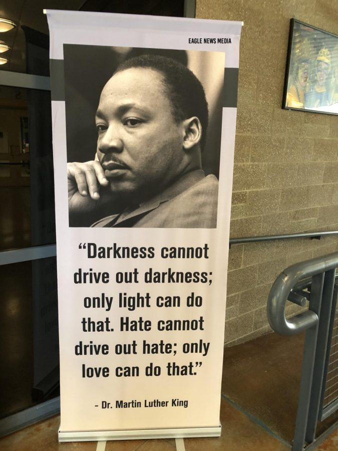 A+poster+of+MLK+with+his+quote%2C+%22Darkness+cannot+drive+out+darkenss%3B+only+light+can+do+that.+Hate+cannot+drive+out+hate%3B+only+love+can+do+that%22+is+displayed+in+the+commons.