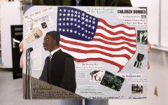 Jayla Nelson proudly holds up the artwork designed by senior Ellie Kikuchi for the MLK assembly.