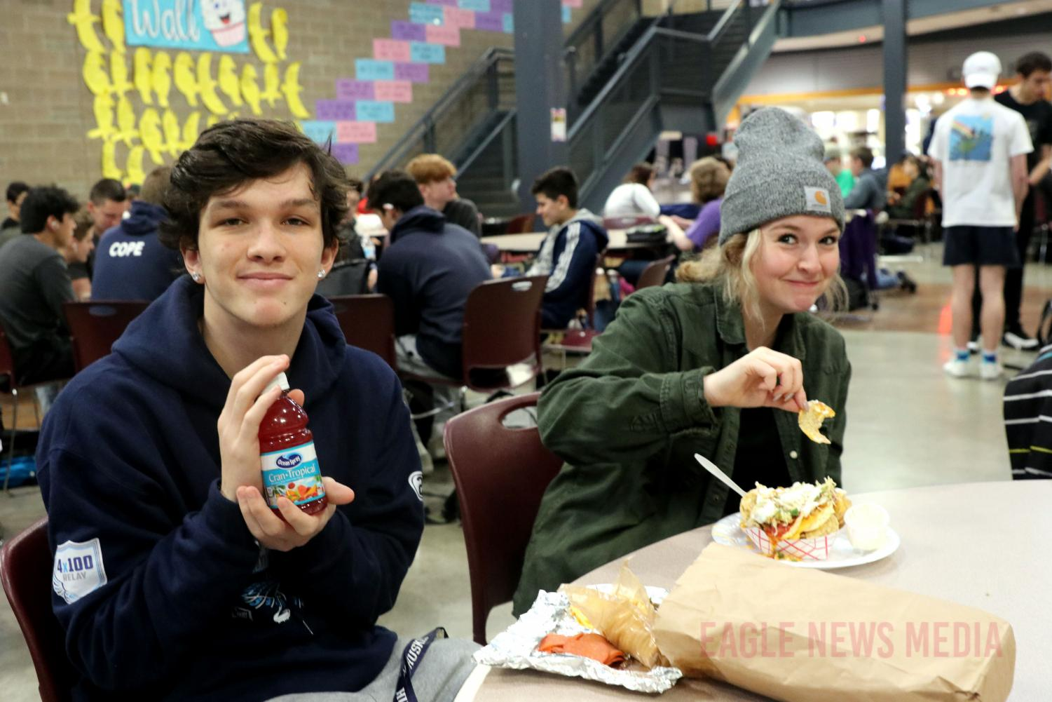 Seniors Chase Peterson and Ashley Contonio eat during first lunch on nacho Friday.