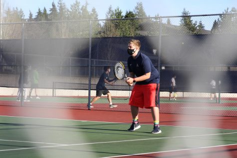 Freshman Ryan Morzelewski is getting ready to receive a serve from Jackson High School opponent Trenton Viscalla.