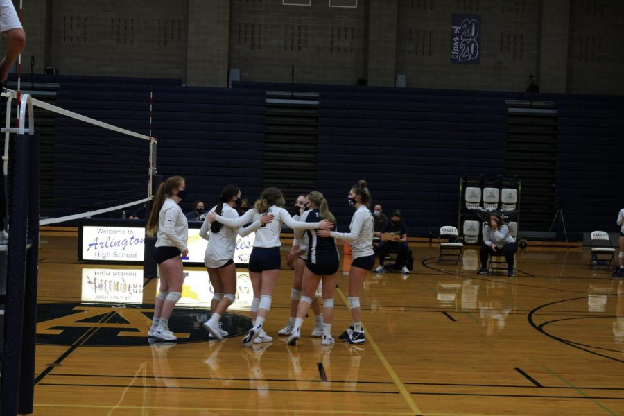 Junior-Varsity volleyball girls come together in between points and keep motivating one another.