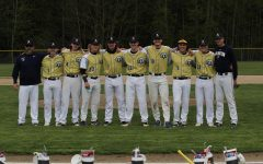 It was senior night for Varsity Baseball! Coaches line up with the eight senior players before they take on Stanwood.