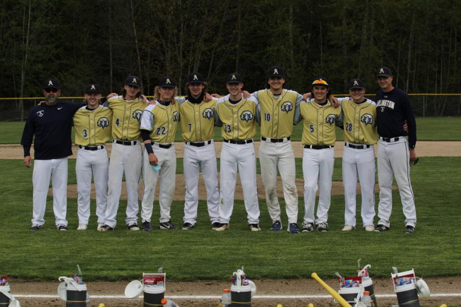 It+was+senior+night+for+Varsity+Baseball%21+Coaches+line+up+with+the+eight+senior+players+before+they+take+on+Stanwood.+